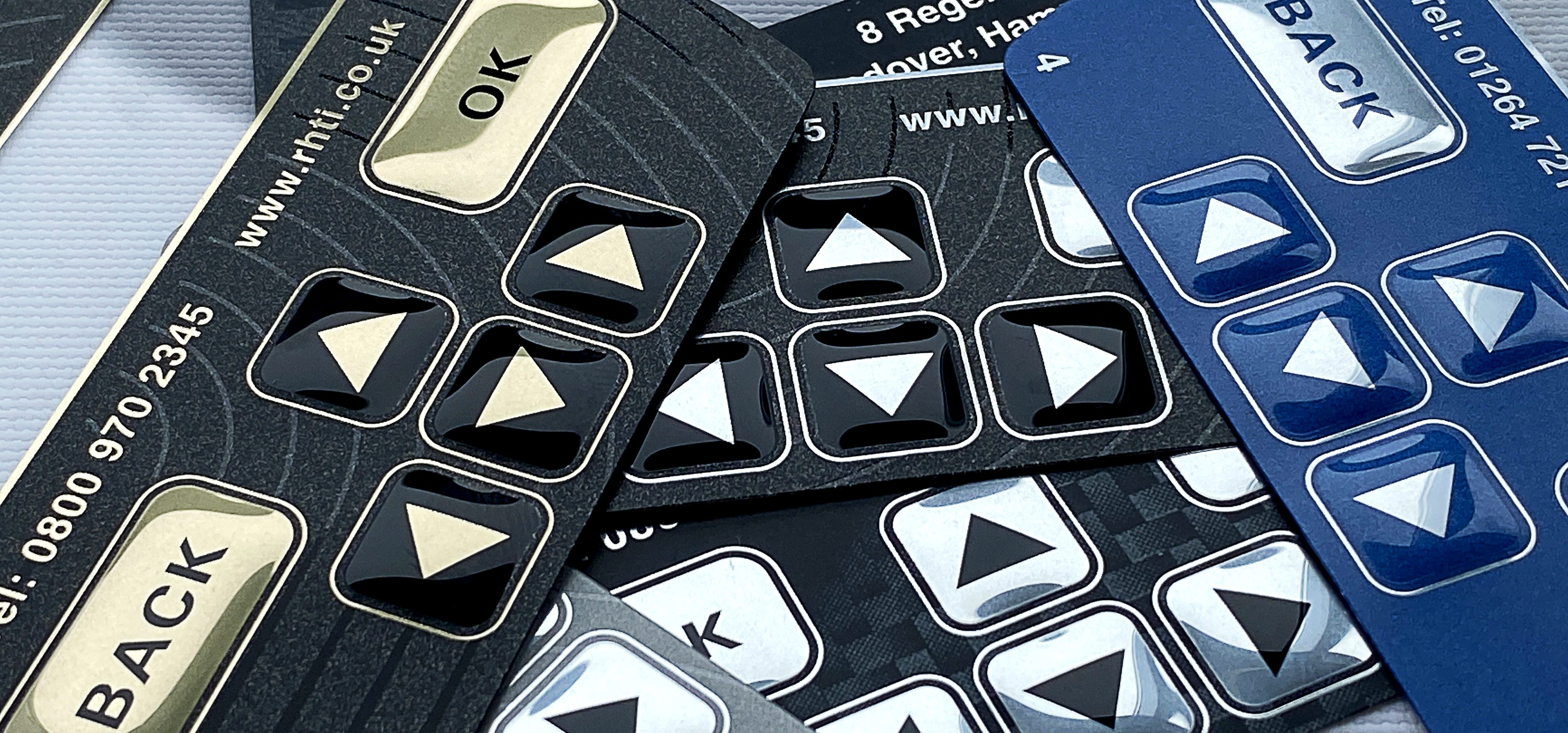 Graphic Overlay Product samples - Embossing and Tactile Finish