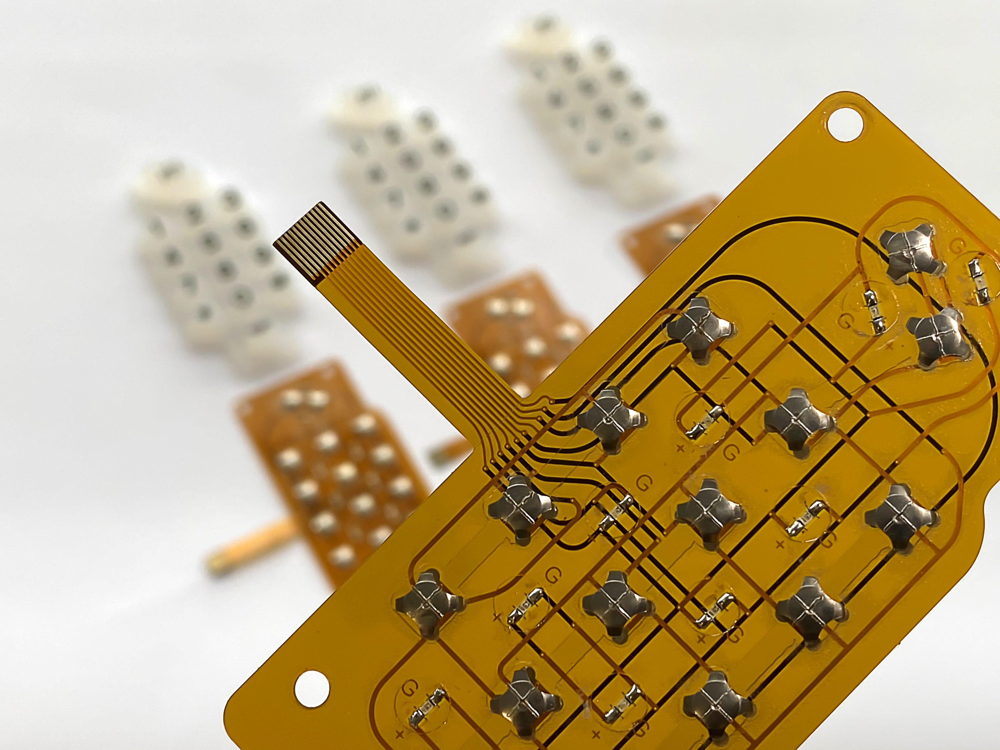 Rubber Keypads - in background behind circuit board