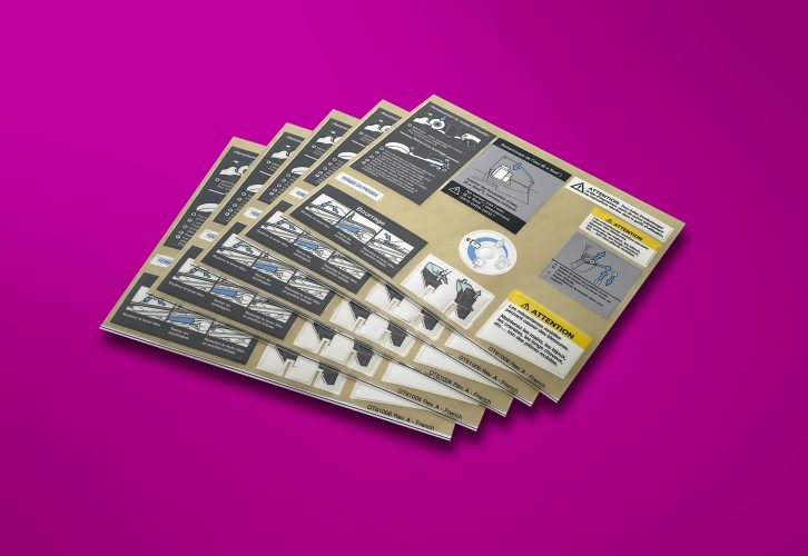 A sheet of peel off custom labels. Label Solutions