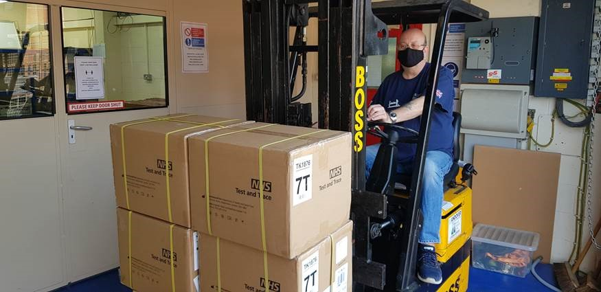 RH receiving delivery of NHS Test and Trace Kits on a pallet with fork lift