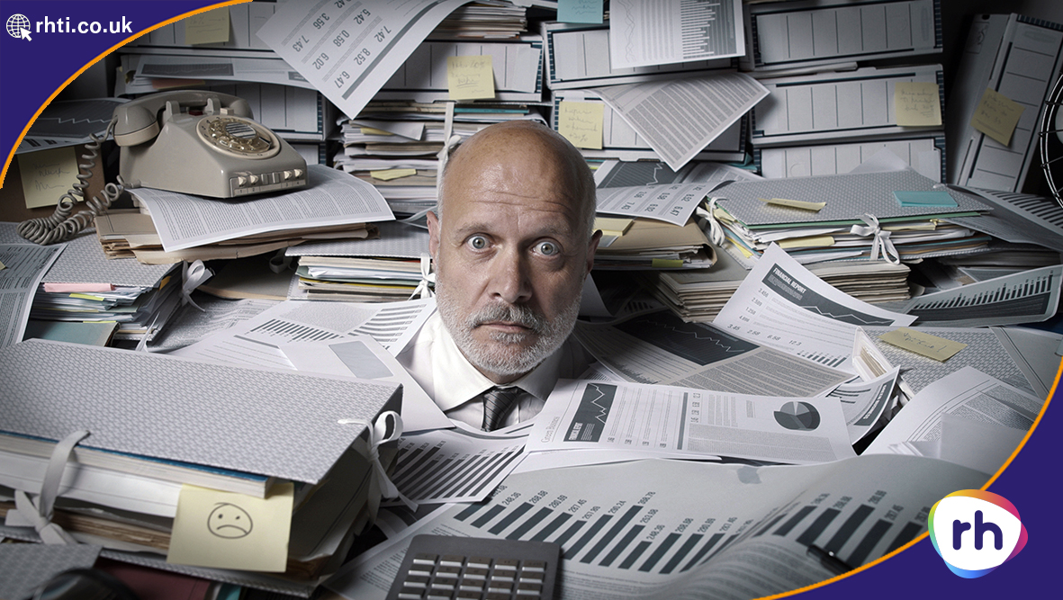 Businessman buried under paperwork - RH has a new HR system